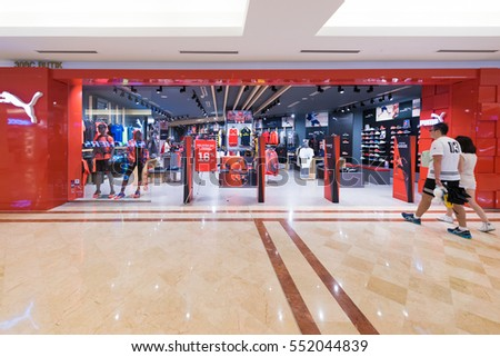 KUALA LUMPUR - SEP. 13, 2016: Puma store in the Suria KLCC mall. PUMA SE is a major German multinational company that designs and manufactures athletic and casual footwear, apparel and accessories.