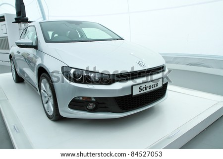 KUALA LUMPUR - SEPT 10: Front view of VW Scirocco on display at the Volkswagen Das Auto Show 2011 on September 10, 2011 in Kuala Lumpur, Malaysia. This event is a promotion for latest Volkswagen models. - stock photo