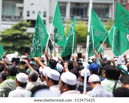 KUALA LUMPUR - SEPTEMBER 22 - A protest against Innocence Muslim, an anti-Islam film which enraged muslims globally, in front of the USA embassy on September 22, 2012. Kuala Lumpur - stock photo