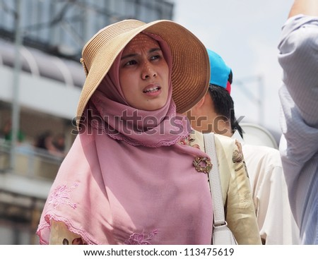 KUALA LUMPUR - SEPTEMBER 22 - Nurul Izzah Anwar, a member of parliment, at the protest against Innocence Muslim in front of the USA embassy on September 22, 2012. Kuala Lumpur - stock photo