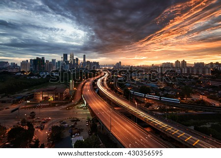Kuala Lumpur Skyline with light trail and beautiful sunset