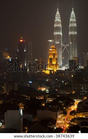 Kuala Lumpur skyline with Petronas Towers - stock photo