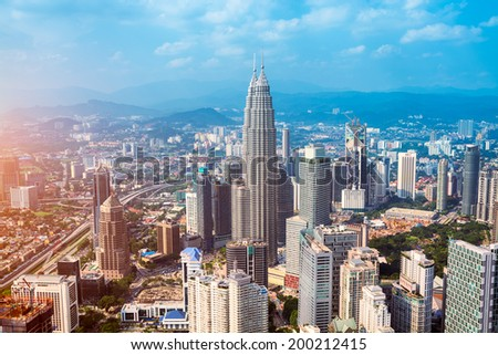 Kuala Lumpur skyline with the Petronas Towers and other skyscrapers. (Malaysia) - stock photo