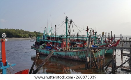 Kuala Selangor,Malaysia -February 14, 2015: fisherman going back to seaport after catching from the ocean in Fishing Village,Sekinchan. - stock photo