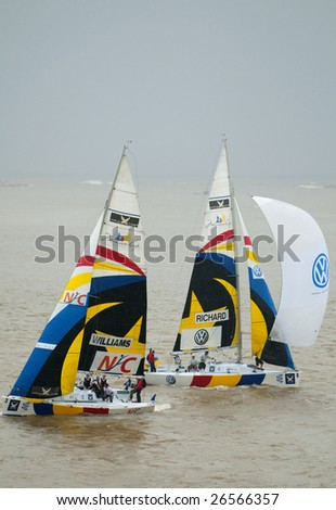 KUALA TERENGGANU, MALAYSIA - DEC 6 : Team Richard and Williams in action in stormy weather at Monsoon Cup 2008 in K. Terengganu, Malaysia on December 6, 2008. Williams finished fourth.