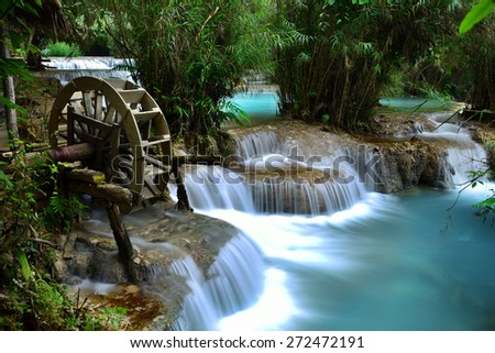 Kuang Si Waterfall is a huge waterfall in deep tropical forest near Luang prabang, Laos - stock photo
