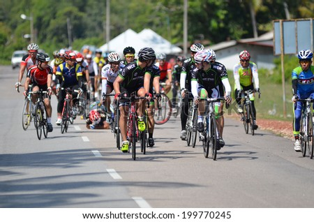 KUANTAN - JUNE 1: unidentified cyclists had a crashed during Kuantan160 on June 1, 2014 in Kuantan, Pahang, Malaysia. KUANTAN160 is a non-profit, non-race 160KM bicycle ride around Kuantan City. - stock photo