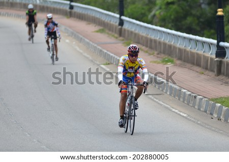 KUANTAN - JUNE 1: unidentified cyclists in action during Kuantan160 on June 1, 2014 in Kuantan, Pahang, Malaysia. KUANTAN160 is a non-profit, non-race 160KM bicycle ride around Kuantan City. - stock photo
