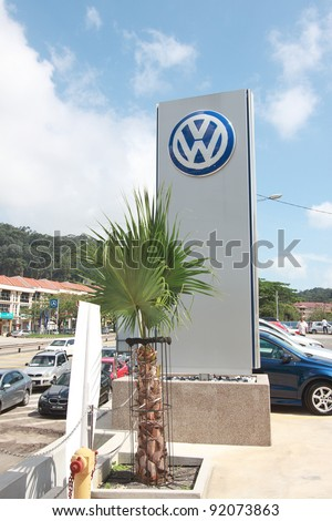 KUANTAN,MALAYSIA-JAN.4: Big Volkswagen logo outside of showroom at the launching of Volkswagen Showroom on Jan 4th 2012 in Kuantan, Pahang, Malaysia. Official opening celebration on Jan 7th& 8th 2012. - stock photo