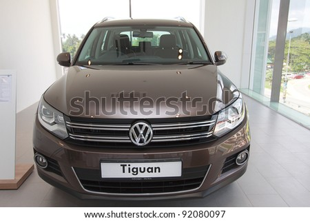 KUANTAN,MALAYSIA-JAN.4: Front view of brown Tiguan at the launching of Volkswagen Showroom on January 4th 2012 in Kuantan, Pahang, Malaysia. Official opening celebration on 7th and 8th January 2012. - stock photo