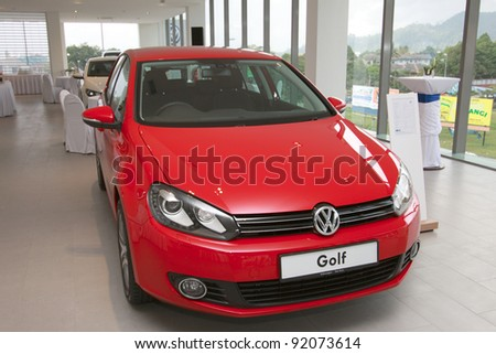 KUANTAN,MALAYSIA-JAN.4: Front view of red Golf at the launching of Volkswagen Showroom on January 4th 2012 in Kuantan, Pahang, Malaysia. Official opening celebration on 7th and 8th January 2012. - stock photo