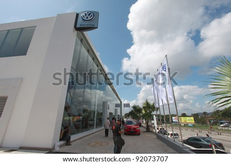 KUANTAN,MALAYSIA-JAN.4: Front view of showroom with blue sky at the launching of Volkswagen Showroom on Jan 4th 2012 in Kuantan, Pahang, Malaysia. Official opening celebration on Jan 7th & 8th 2012. - stock photo