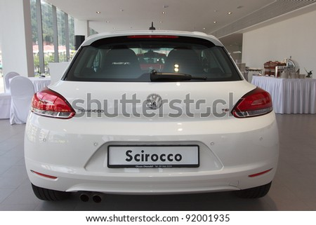 KUANTAN,MALAYSIA-JAN.4: Rear view of white Scirocco at the launching of Volkswagen Showroom on January 4th 2012 in Kuantan, Pahang, Malaysia. Official opening celebration on 7th and 8th January 2012. - stock photo