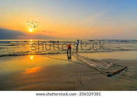 KUANTAN, MALAYSIA - JULY 20, 2014 - Fishermen do their work near Beserah beach, Kuantan, Malaysia at July 20, 2014. Fishermen are the main occupation for villagers at Kuantan village, Pahang