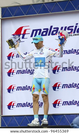 KUANTAN, MALAYSIA - MARCH 1: Alexandr Dyachenko in Astana Pro Team winning for Leading Asian Riders category in stage 7 race of the Le Tour de Langkawi on March 1, 2012 in Kuantan, Malaysia. - stock photo