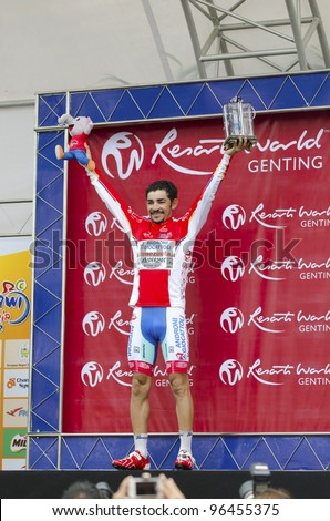 KUANTAN, MALAYSIA - MARCH 1: Jose Serpa in Androni Giocattoli team winning for Mountains Competition category in stage 7 race of the Le Tour de Langkawi on March 1, 2012 in Kuantan, Malaysia. - stock photo