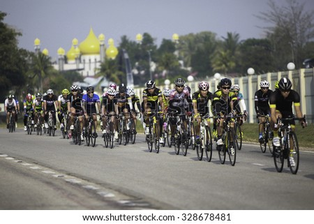 KUANTAN - MARCH 12: a group of cyclists in action during stage five of the 2015 Le Tour de Langkawi (LTdL) on March 12, 2015 in Kuantan, Pahang, Malaysia.