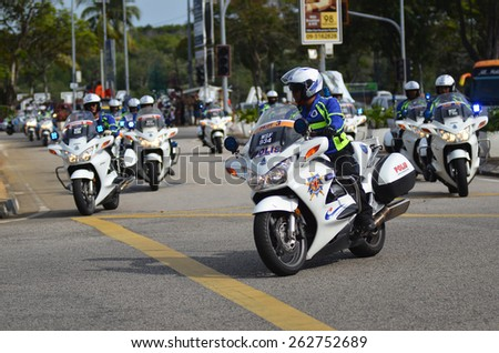 KUANTAN - MARCH 12: a group of policeman in action during stage five of the 2015 Le Tour de Langkawi (LTdL) on March 12, 2015 in Kuantan, Pahang, Malaysia. - stock photo
