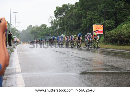 KUANTAN - MARCH 2: Second group cyclists in action during Stage 8 of the le Tour de Langkawi from Pekan to Cukai on March 2, 2012 in Kuantan, Pahang, Malaysia.