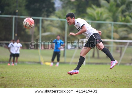 Kuantan, Pahang - April 8: Faizal Abdul Rani heads the ball during the training Pahang FC Team at Taman Gelora field for preparation next match for Malaysian Super League - stock photo