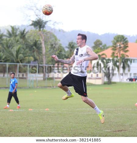 Kuantan, Pahang - JAN 28: Pahang defender, Nejc potokar heads the ball during the training Pahang FC Team at Taman Gelora field - stock photo