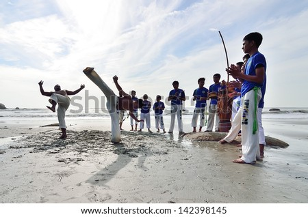 KUANTAN, PAHANG-JAN 5 : Real capoeira performance at Teluk Cempedak beach, Kuantan, Pahang on Jan 5, 2013. Capoeira is an Afro-Brazilian art form that combines elements of martial arts and dance - stock photo