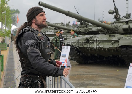 """KUBINKA, MOSCOW OBLAST, RUSSIA - JUN 16, 2015: Alexander Zaldostanov (Surgeon), is a leader Russian largest motorcycle club """"Night Wolves"""" at the International military-technical forum ARMY-2015 - stock photo"""