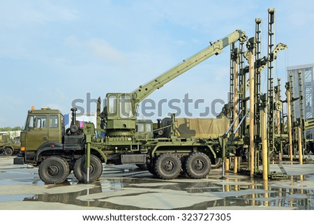 KUBINKA, MOSCOW OBLAST, RUSSIA - JUN 15, 2015: International military-technical forum ARMY-2015 in military-Patriotic park. Self-propelled bridge building installation USM-3 - stock photo