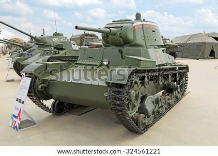 KUBINKA, MOSCOW OBLAST, RUSSIA - JUN 15, 2015: International military-technical forum ARMY-2015 in military-Patriotic park. The T-26 Soviet-designed light retro tank, produced 1939 - stock photo
