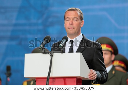 KUBINKA, MOSCOW OBLAST, RUSSIA - JUN 19, 2015: The Prime Minister of Russia Dmitry Medvedev with his eyes closed at the closing ceremony of the International military-technical forum ARMY-2015 - stock photo