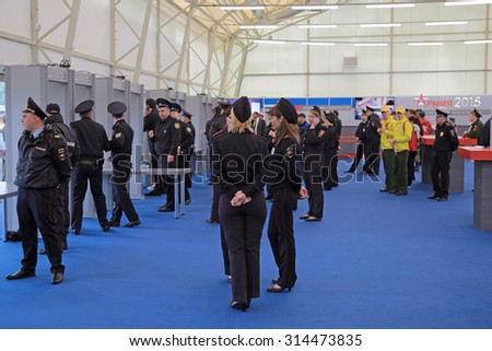 KUBINKA, MOSCOW OBLAST, RUSSIA - JUN 16, 2015: The screening visitors - police work at the International military-technical forum ARMY-2015 in military-Patriotic park. - stock photo