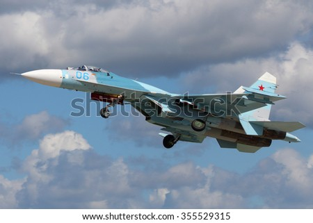 KUBINKA, MOSCOW REGION, RUSSIA - JUNE 9, 2015: Sukhoi SU-27 RF-RF-95612 of russian air force taking off at Kubinka air force base during Army-2015 forum - stock photo