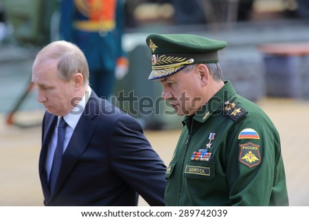 KUBINKA, RUSSIA - JUN 16, 2015: The Minister of Defense Sergey Shoygu and president of Russia Vladimir Putin at the International military-technical forum ARMY-2015 in military-Patriotic park - stock photo