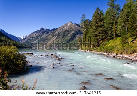 Kucherla lake and river in the Altai Mountains, Russia - stock photo