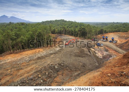 KUCHING, MALAYSIA - MAY 16 2015: Deforestation. Photo of tropical rain forest in Borneo being destroyed to make way for oil palm plantation. - stock photo