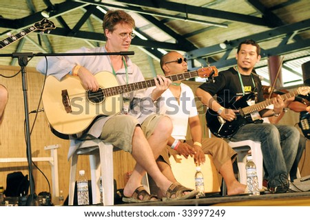 KUCHING, SARAWAK - JUL 12: Greg Henderson of AkashA performs at the 12th edition Rainforest World Music Festival's workshop, Sarawak Cultural Village on July 12, 2009 in Santubong, Sarawak.