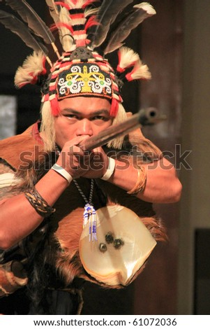 KUCHING, SARAWAK, MALAYSIA - SEPTEMBER 13: The Iban Warrior demonstrating a traditional dart at the Sarawak Cultural Village on September 13, 2010 in Santubong, Sarawak. - stock photo