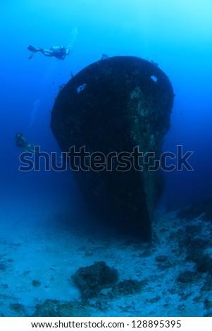 Kuda Giri shipwreck and scuba divers - stock photo