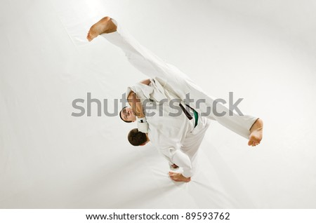 Kudo karate fight. Fighter performing a throw - stock photo