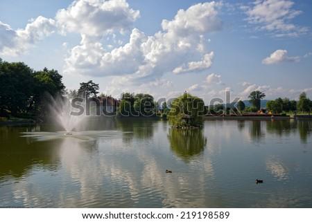 KUDOWA ZDROJ, POLAND - August 06, 2014: Spa gardens, pond - stock photo