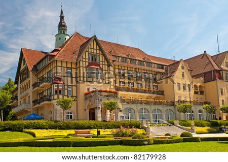KUDOWA ZDROJ, POLAND - JULY 17: View of Sanatorium Polonia in spa town Kudowa Zdroj on July 17, 2011. Kudowa Zdroj is one of the oldest spa resorts in Poland & Europe and was built in 16th century. - stock photo