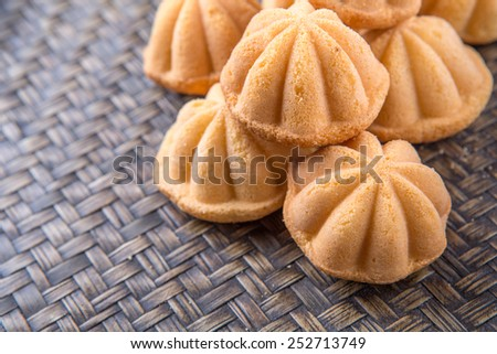 Kuih bahulu, a Malay sweet egg sponge cake on wicker mat