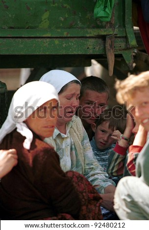 KUKES, ALBANIA - MAY 4: Kosovar Albanians at a refugee camp in northern Albania. The Kosovar Albanians were ethnically cleansed from their homes in Kosovo by Serbian security forces on May 4, 1999 in Kukes, Albania.