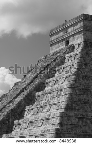 Kukulcan temple at Chichen Itza in Mexico.  Black and white. - stock photo