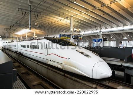 Kumamoto - August 12, 2014 : A Shinkansen Bullet Train of Kyushu in Kumamoto, Japan. - stock photo
