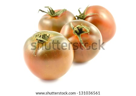 Kumato tomatoes on a white background close-up - stock photo