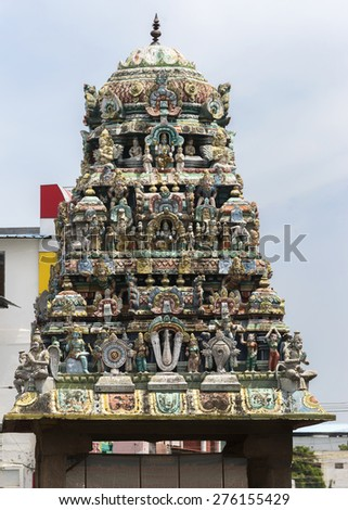 KUMBAKONAM, INDIA - OCTOBER 12, 2013: Sarangapani Vishnu Temple. About hundred meters in front of the main entrance to the temple, stands a small shrine with this short gopuram on top. The Vishnu V.