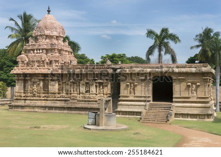 KUMBAKONAM, INDIA - OCTOBER 11, 2013: The Amman Shrine stands in the garden on the North side of the Gangaikunda Temple. A small well is seen as well. - stock photo