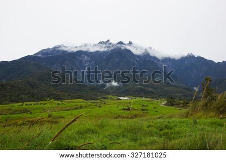 KUNDASANG, MALAYSIA - 18TH FEBRUARY 2013; View of Mount Kinbalu from Mesilau dairy farm at Sabah, Malaysia. - stock photo