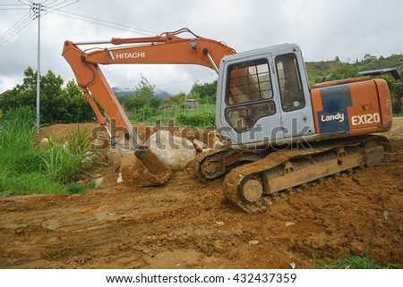 Kundasang Sabah Malaysia - June 5, 2016 : Japanese brand excavator seen on construction site at Mesilau Village in Kundasang Sabah on June 5, 2016. Used construction machinery is popular in Sabah.